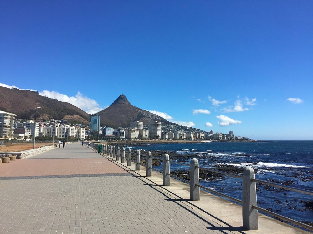 Sea Point Promenade with Lion's Head in the background.